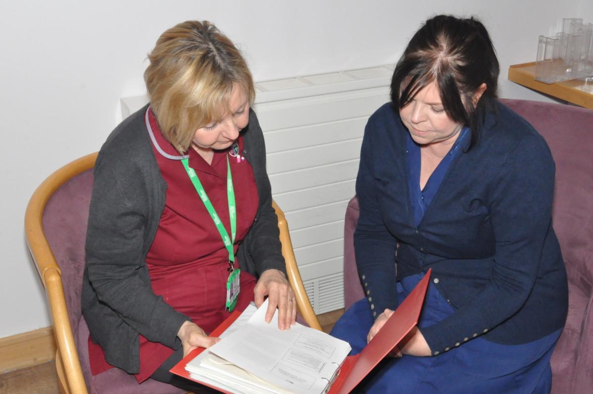 Nurse showing patient information