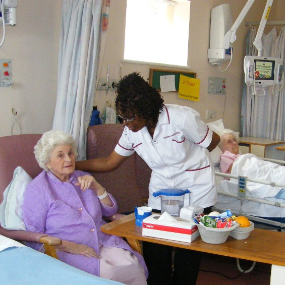 A nurse caring for an elderly patient