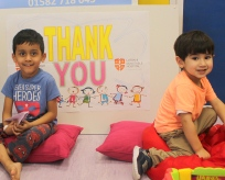 Thank you sign with children in the play room