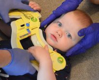 Photo of a baby in life saving equipment