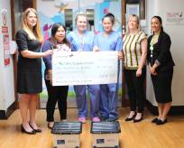 George Hay Chartered Accountants presenting a cheque with members of the NICU team