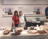 Staff helping at the cake sale