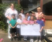 Watling Lower School presenting us with a cheque