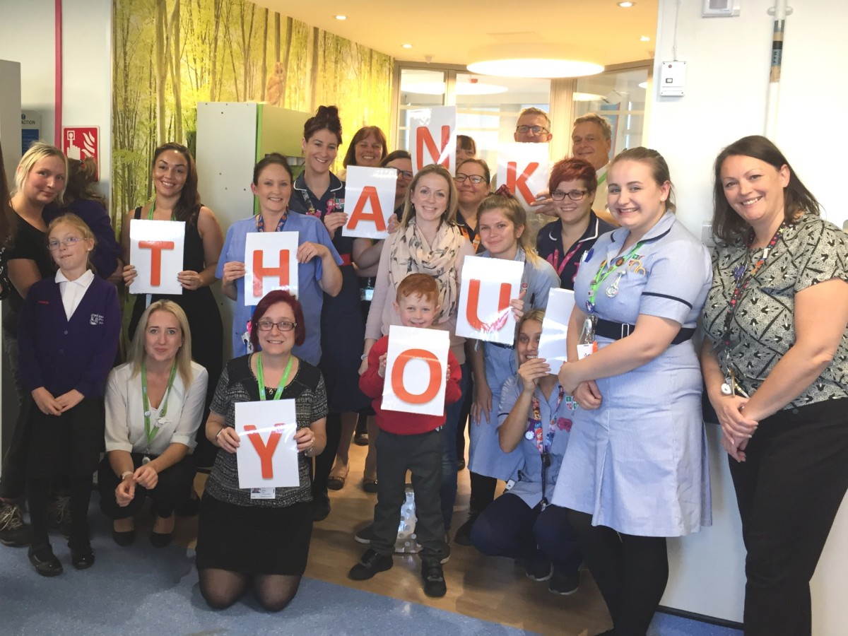 Thank you photo of staff and patients
