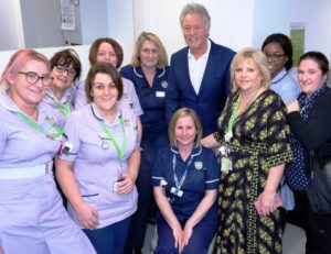 Paul Young with staff