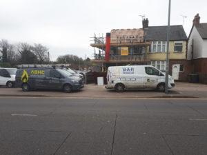 Work vans outside NICU house