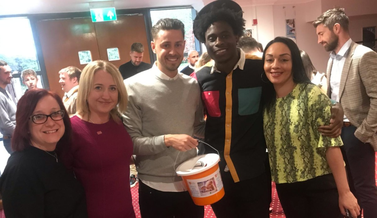 Fundraising team with LTFC players