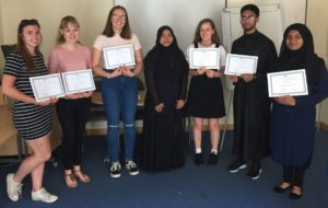 Young volunteers receiving certificates