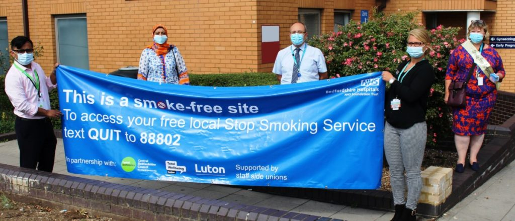 Picture of Staff holding Smoke free banner